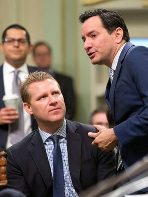 Assemblyman Chad Mayes and Assembly Speaker Anthony Rendon confer at the Capitol in Sacramento.