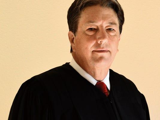 Chief Judge James W. Counts.