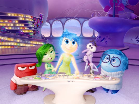 """In this file image released by Disney-Pixar, characters, from left, Anger, voiced by Lewis Black, Disgust, voiced by Mindy Kaling, Joy, voiced by Amy Poehler, Fear, voiced by Bill Hader, and Sadness, voiced by Phyllis Smith appear in a scene from """"Inside Out."""" The movie releases in theaters on June 19, 2015."""