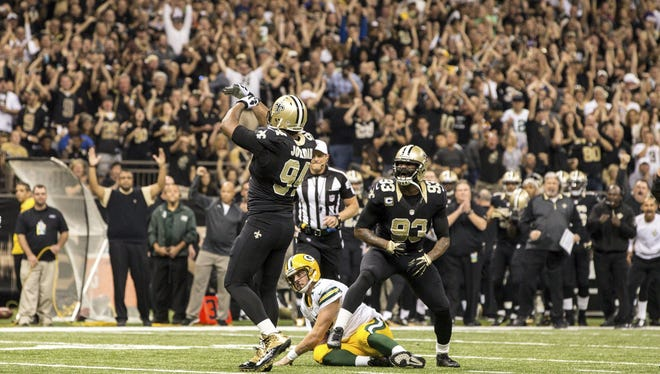 The Saints celebrate in the Superdome during their victory against Green Bay.
