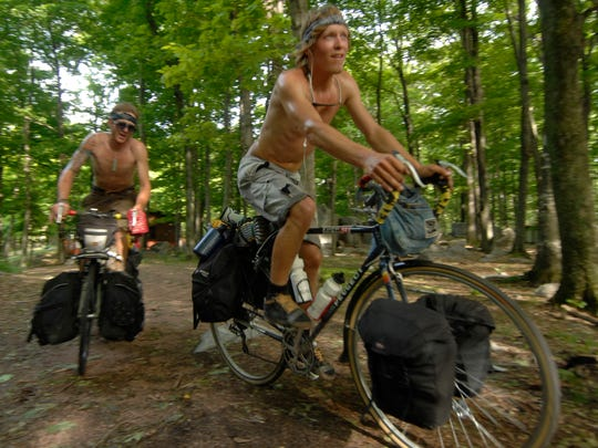 Brett Stepanik and Jerod Anklam, right, make their way to the top of Rib Mountain in 2008 to complete their biking trip from California to Wisconsin.
