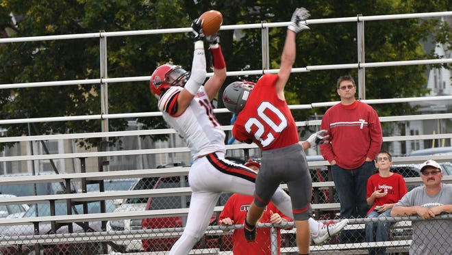SJCC's Grant Stepanic, right, was at a size disadvantage on this touchdown pass. Stepanic, however, rebounded with an interception early in the second half.