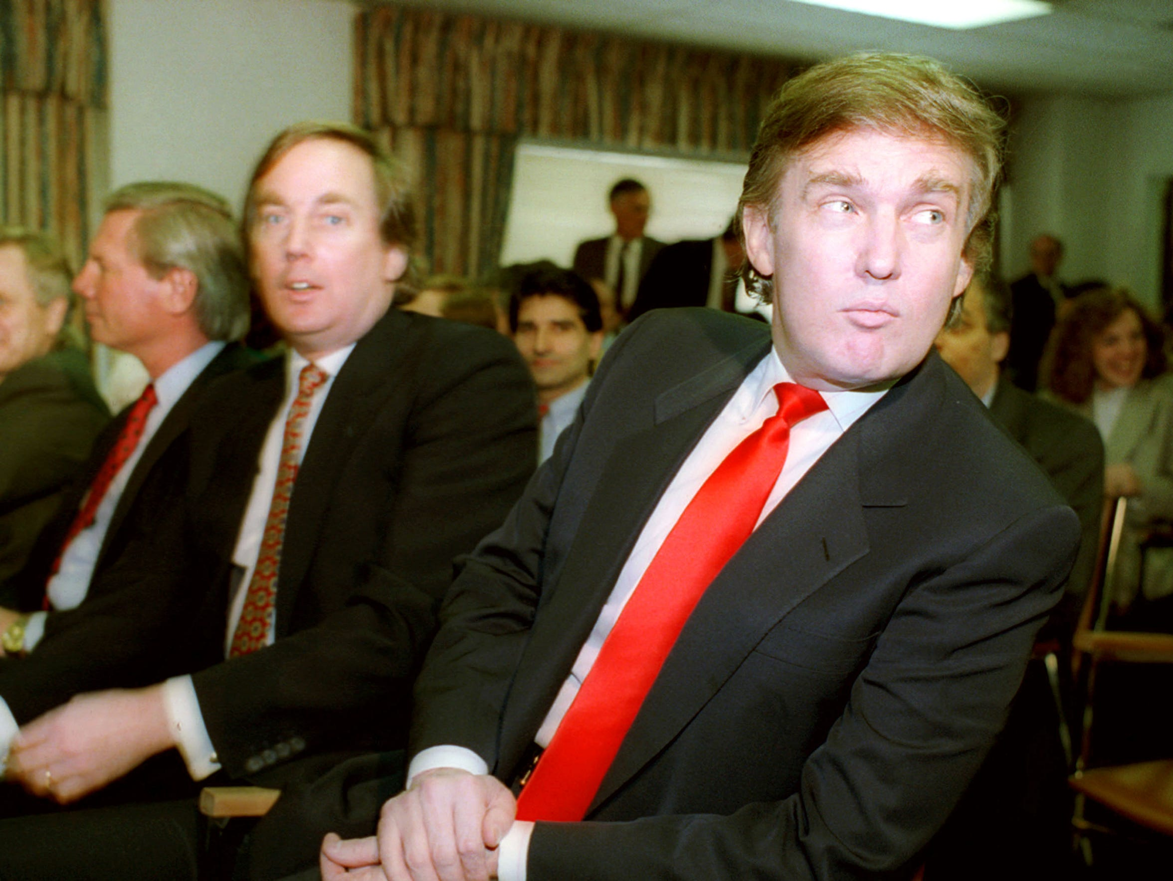 Donald Trump, right, waits with his brother Robert