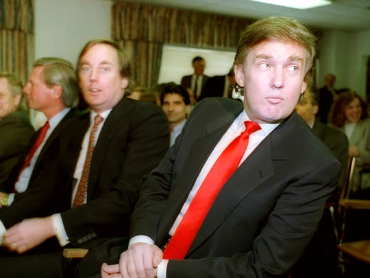 Donald Trump, right, waits with his brother Robert for the start of a Casino Control Commission meeting in Atlantic City on March 29, 1990. Trump was seeking final approval for the Taj Mahal Casino Resort, one of the world's largest casino complexes.