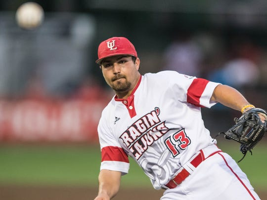 "Cajuns second baseman Brenn Conrad misfires on a throw to first base in an error that cost the Cajuns in the seventh inning in their 6-3 loss to Louisiana Tech Wednesday at M.L. ""Tigue"" Moore Field."