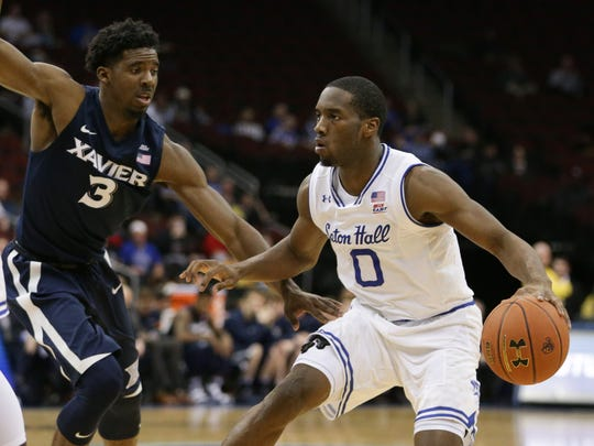 Seton Hall guard Khadeen Carrington (0) dribbles as Xavier Musketeers guard Quentin Goodin (3) defends during the second half of a game on Feb. 22.