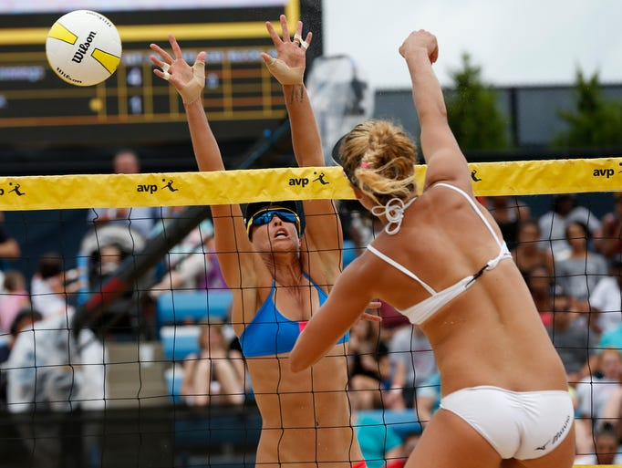 Kerri Walsh Jennings spikes the ball against Lauren Fendrick during their championship match in the AVP Cincinnati Open in Mason.