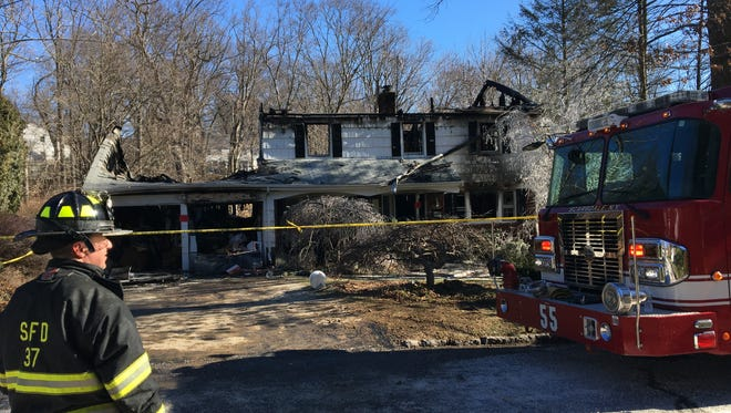 The charred remains of the home at 29 Black Birch Lane, Scarsdale after a fire early Sunday morning.