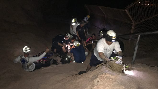 Phoenix fire crews rescued a woman from Camelback Mountain on Thursday night.