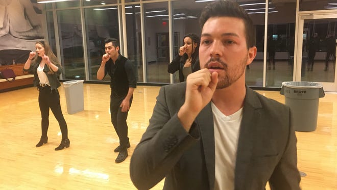 ASU Law Cappella co-founder Drew Hensley rehearses with the group at the downtown Phoenix YMCA.