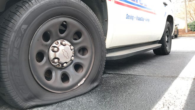 Several Greenville Police Department vehicles had tires slashed while parked outside the department.
