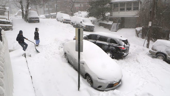 A car gets turned around as he tries to escape the icy hill on Caryl Avenue in Yonkers during the snowstorm.
