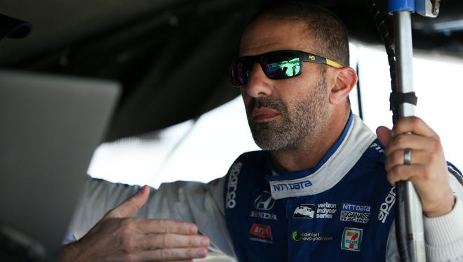 Tony Kanaan confers with his team while getting ready for the Kohler Grand Prix at Road America.He finished second in the event last year.