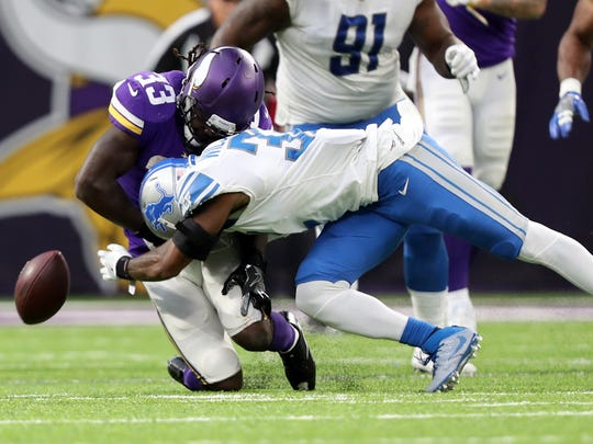 Oct 1, 2017; Minneapolis, MN, USA; Lions safety Tavon Wilson forces a fumble on Vikings running back Dalvin Cook in the third quarter at U.S. Bank Stadium. Cook injured his knee before the hit.