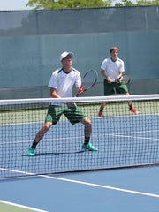 Sycamore's top doubles team of senior Alex Taylor (foreground)