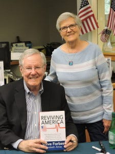 Forbes at Sunday's signing with a book fan.  (Bergeron Image)