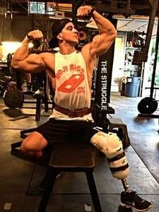 Jacob Murillo, 23, of Norwalk, flexes for the picture in his uncle's garage-based gym just weeks after having his left leg amputated just below the knee.