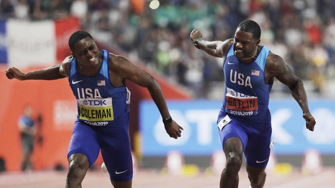 Christian Coleman, left, edges Justin Gatlin to win the men's 100 meters at last year' world championships in Doha, Qatar.