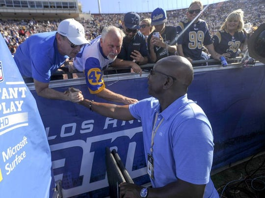 Eric Dickerson greets fans before a preseason game earlier this year at the Coliseum. The former Rams great has clashed with head coach Jeff Fisher and won't be on a the Rams' sideline anytime soon.