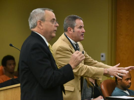 Knox County Assistant District Attorney Phil Morton, left, and defense attorney T. Scott Jones, center, argue over evidence during a hearing for Christopher Drone Bassett Jr., seated bottom right, in Knox County Sessions Court on Feb. 25, 2016.