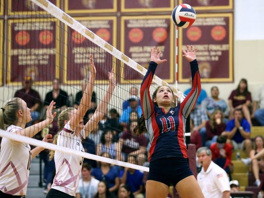 GABE HERNANDEZ/CALLER-TIMES Veterans Memorial's Jazmine Perez sets the ball against Tuloso-Midway on Tuesday at Tuloso-Midway High School.