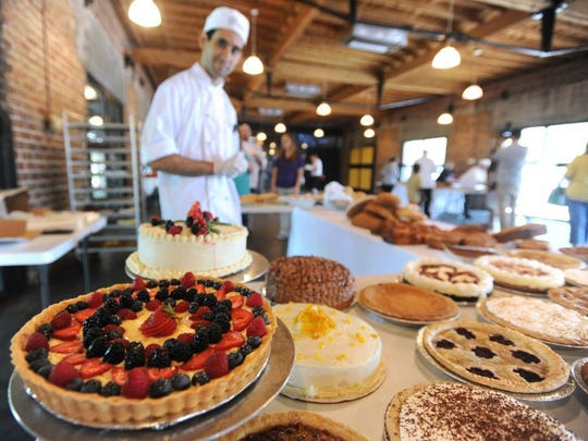 Nellie Doneva/Reporter-News Gabe Bishop prepares to package a variety of pies, tarts, cakes and quiches for customers Wednesday at the annual Texas State Technical College Culinary Arts Bake Sale.