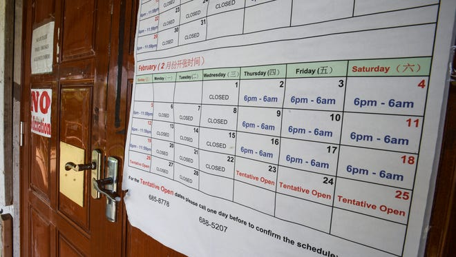 A calendar for the months of January and February, can be found posted at the main entrance of a building housing a casino operation in Tiyan, Barrigada on Feb. 1, 2017. Metal stalls that once housed Liberation Day carnival concessions at the fair grounds have remained dormant since the fair closed last year in August. However, the calendar posted indicates the temporary gambling venue continues to be operated during the evening and early morning hours of most Thursdays, Fridays and Saturdays, and evening hours of most Sundays. Local anti-gambling group, Lina'la Sin Casino, has raised concerns on the extended operation of the establishment.