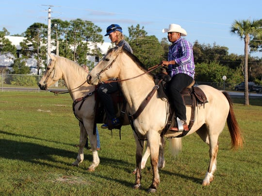 New York Mets outfielder Yoenis Cespedes (right) and pitcher Noah Syndergaard ride horses at the team's spring training baseball facility Tuesday, March 1, 2016, in Port St. Lucia. (Will Carafello/New York Mets via AP)