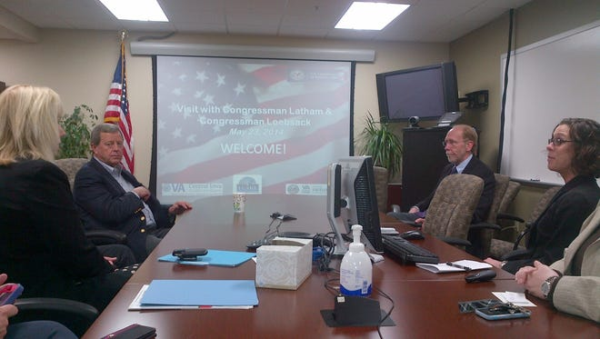 Congressmen Loebsack and Latham meet with leaders of the Veteran Affairs Central Iowa Health Care System on May 23, 2014.