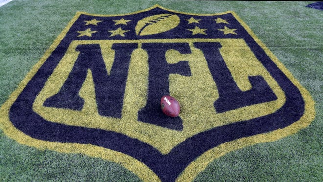 In this Sept. 27, 2015, file photo, a football sits on the NFL logo before a game in Houston.