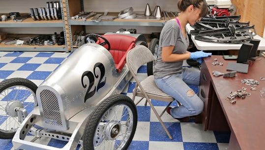 Alex Morales, a mechanic at the Vintage Kart Co., preps metal tabs for painting in Mesa.
