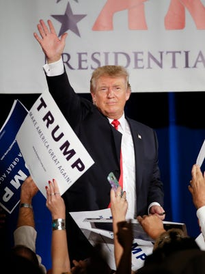 Republican presidential candidate Donald Trump waves after speaking on Aug. 29, 2015, in Nashville.