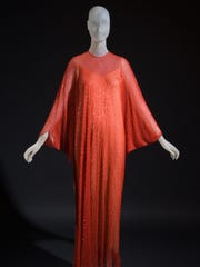Halston designed this evening caftan made of red-beaded