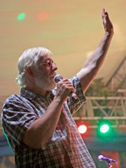 The late Groovefest founder Tim Cretsinger addresses the crowd at Groovefest 2012. A memorial for Tim will be held Sept. 30 at the Cedar Canyon Nature Park.