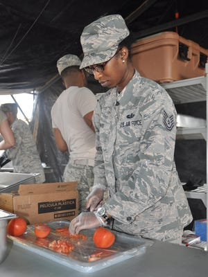 Tech. Sgt. Tekima Howard slices a tomato during the competition on Feb. 11 at Maxwell Air Force Base. The 908th is one of four teams competing for the John L. Hennessy Award that recognizes those who best excel in food service.