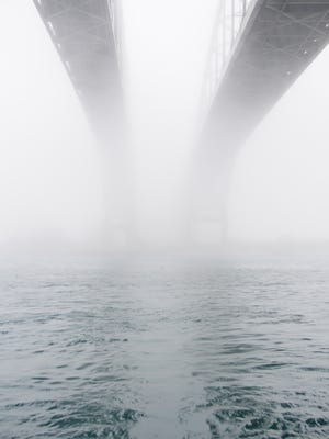 The Blue Water Bridge disappears into the fog.