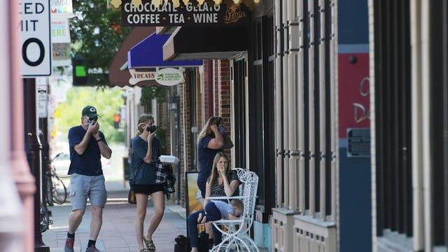 A group of People wearing masks walk around downtown Ames on Tuesday, Aug. 4. File Photo by Nirmalendu Majumdar/ Ames Tribune
