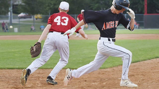 Ames' Nathan Withers reaches the first base as Roland-Story's first baseman Alex Berends waits for over throw ball during the 5th inning at Roland-Story Baseball field Tuesday, July 7, 2020, in Story City, Iowa. Photo by Nirmalendu Majumdar