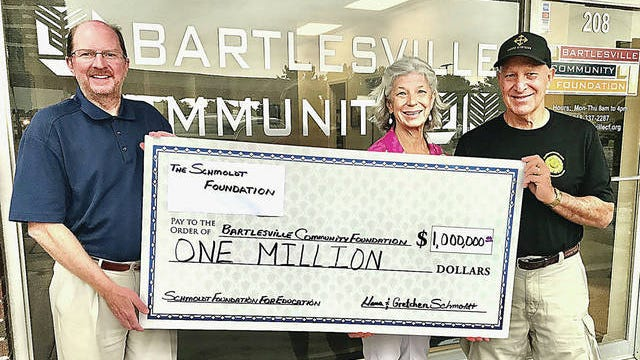 Bartlesville Community Foundation Executive Director Mike Wilt, left, recently accepted a $1 million donation from Hans Schmoldt Jr., right, his sister Gretchen Wettlin, and son Cary Schmoldt (not pictured). The Schmoldt family continues its legacy of giving by working with the BCF to create and provide grants from the Schmoldt Family Foundation for Education after the passing of parents Hans and Jimmie Schmoldt. Courtesy