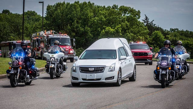 The body of Spring Hill firefighter Mitchell Earwood is escorted from the Davidson County Medical Examiner on R.S. Gass Blvd., Monday. Earwood was killed by a weather-related incident at his home on Sunday.