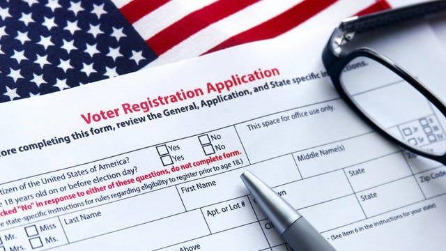 Voter registration application with U.S. flag.