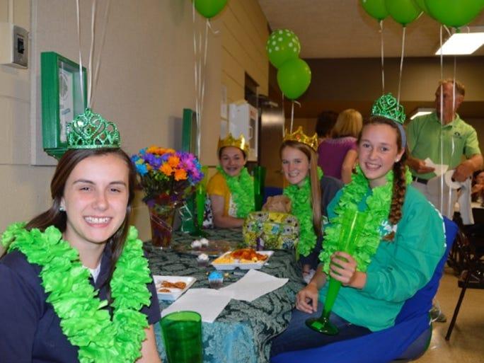 St. Columban seventh- and eighth-graders Anne-Marie Groeschen, Olivia Kelleher, Sydney Robinson and Joelle Zielinski.