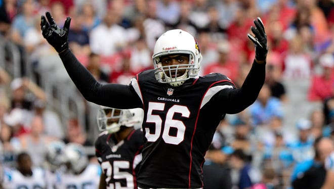 Cardinals linebacker Karlos Dansbypumps up the crowd during the first half.