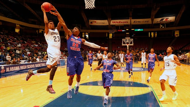 J.O. Johnson's John Petty drives to the basket against Wilcox Central in boys' Class 4A state basketball semifinal, Wednesday, Feb. 26, 2014, in Birmingham, Ala. (AP Photo/Hal Yeager)