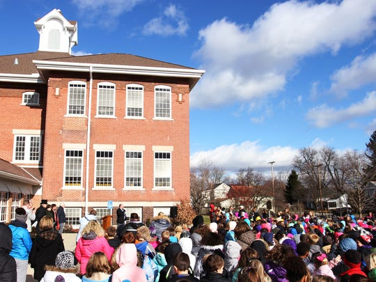 A large crowd of Pataskala Elementary students listens