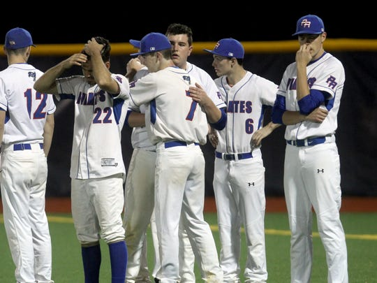 Pearl River players console each other after losing to Saugerties 3-0 in a Class A regional semifinal baseball game at Pace University in Pleasantville June 1, 2017.