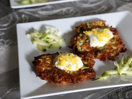Lemon drop cocktails served with zucchini latkes, garnished with sour cream and lemon zest.
