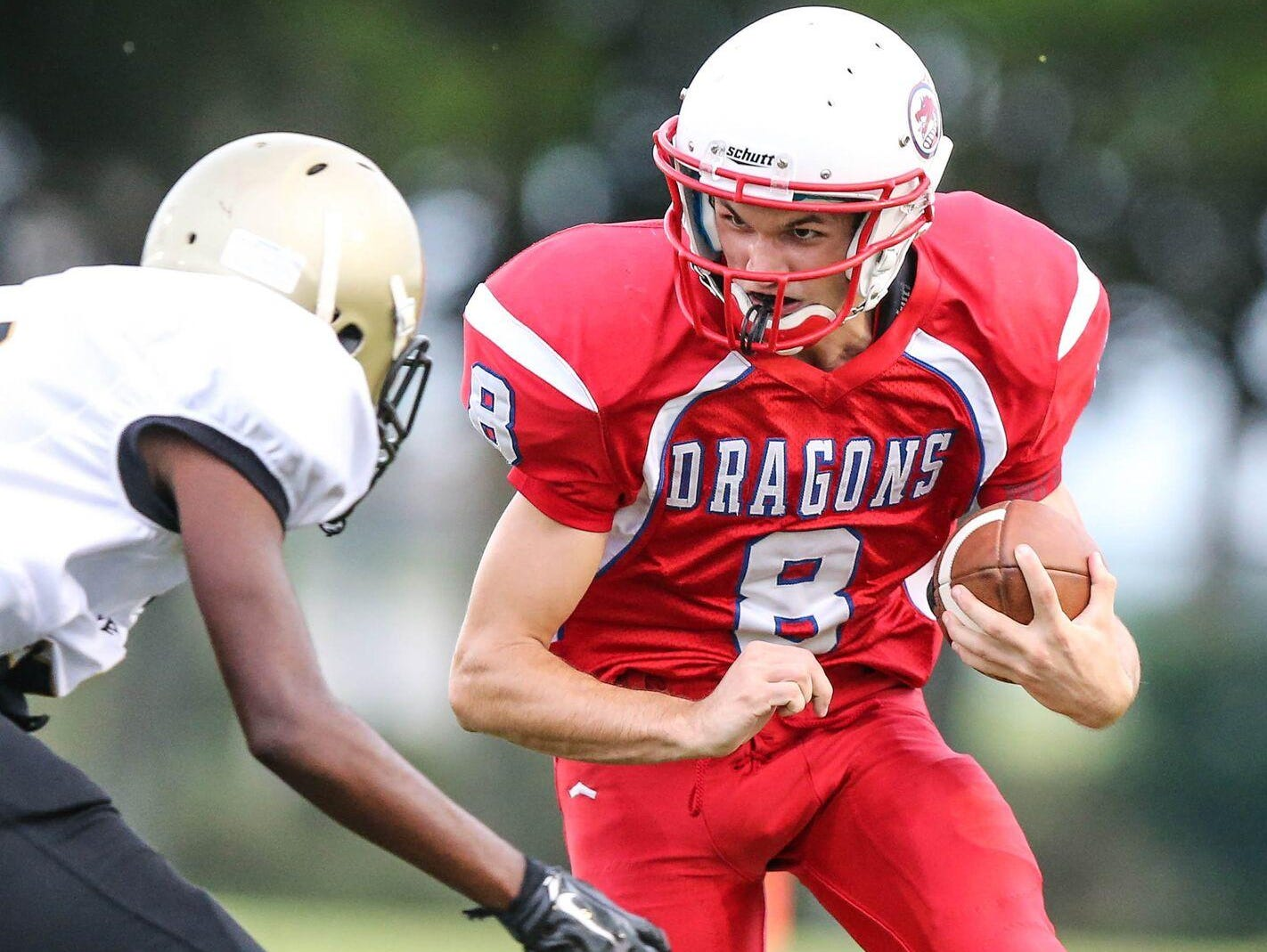 FSDB football player Tyler Ames takes on a Halifax Academy defender during a game early in the 2015 season. The Dragons completed their 102nd season of football two weeks ago.