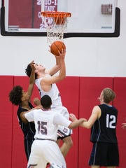 Wade Hampton's Will Edwards (42) shoots the ball during a playoff game at Wade Hampton High School on Wednesday, February 15, 2017.