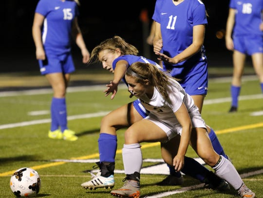 Corning's Hailey Bicknell, front, battles for possession